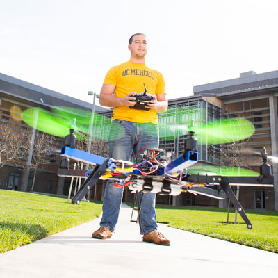 UC Merced - Engineering - Student flying drone in quad