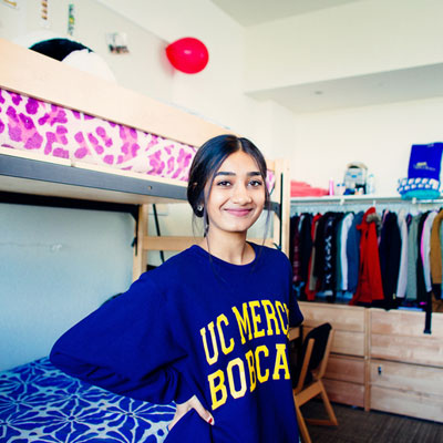 UC Merced - Housing - Student in dorm room