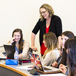 Students in classroom with advisor